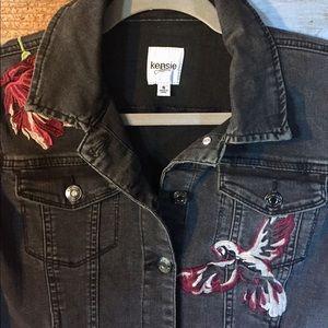 Black denim jacket with artistic details